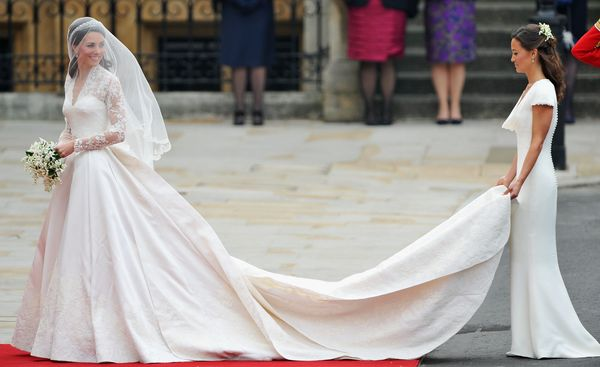 CatherineMiddleton stunned in her Sarah Burton-designed gown, which featured long lace sleeves, a full skirt and a cath