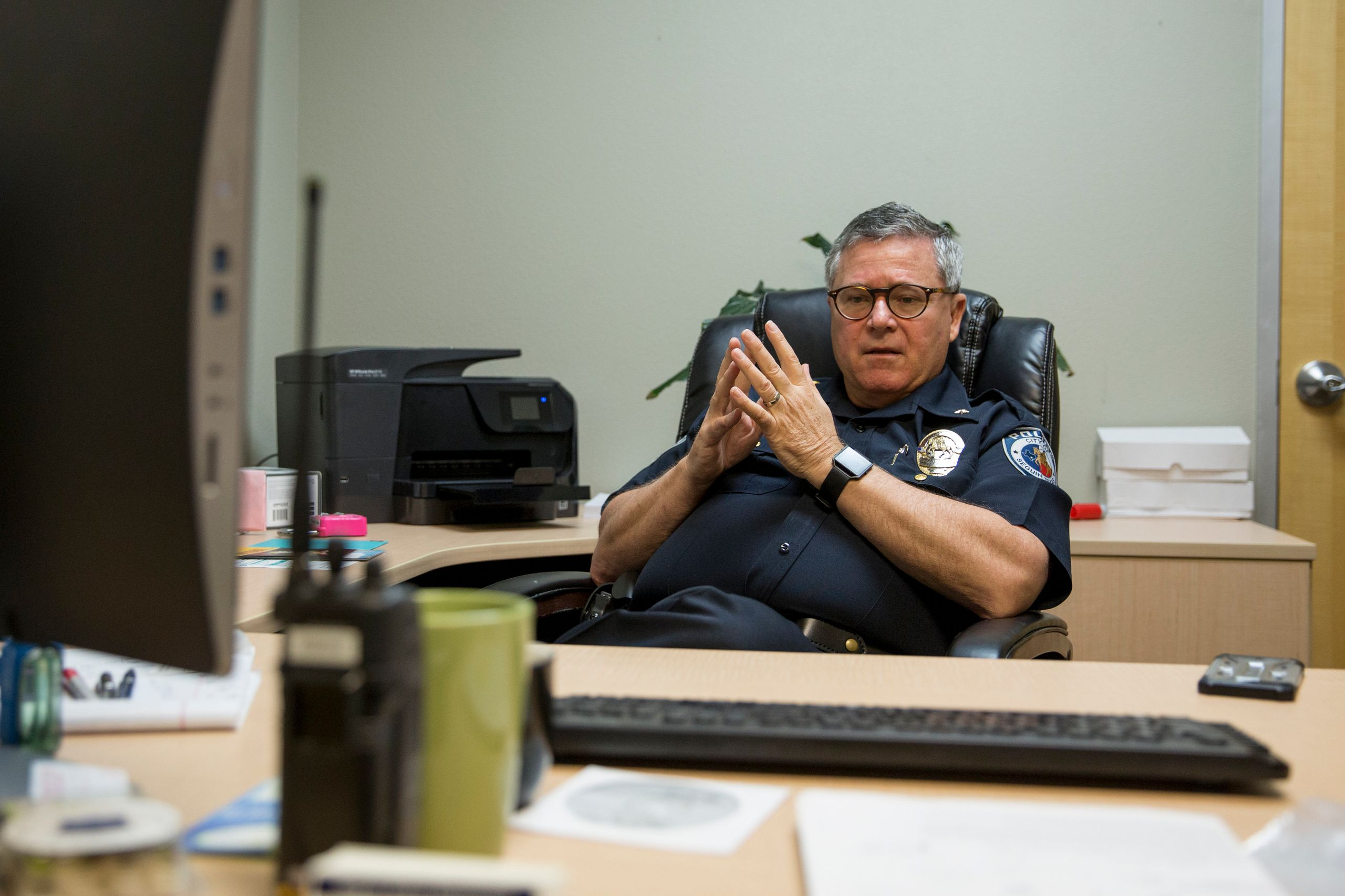 Bruce Ure back at his desk as deputy chief of the police department in Seguin, Texas.