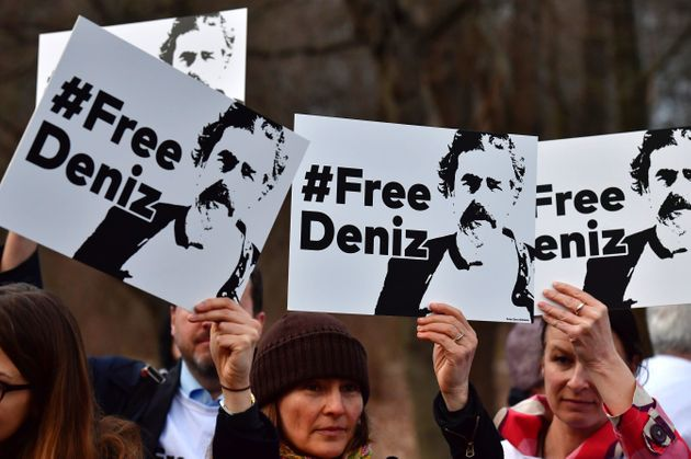 Protesters in Berlin call for the release of German journalist Deniz Yücel, who has been...