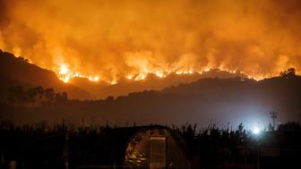 CARPINTERIA, CALIF. -- SUNDAY, DECEMBER 10, 2017: The thomas fire burns in the mountains near Carpinteria, Calif., on Dec. 10, 2017. (Photo by Marcus Yam/Los Angeles Times via Getty Images)
