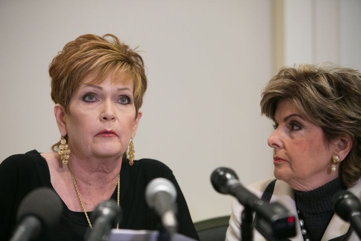 Beverly Young Nelson, left, with attorney Gloria Allred, reads a statement about her experience as a teenager with Roy Moore.