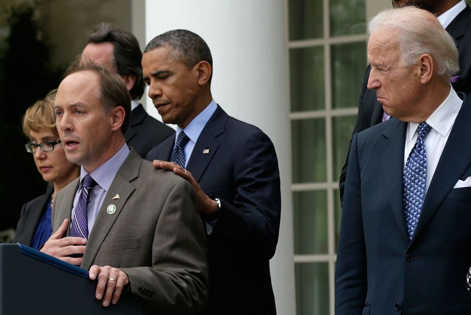 Mark Barden joins President Barack Obama and Vice President Joe Biden to make a statement on gun violence at the White House in April of 2013.