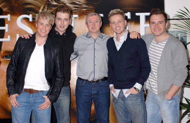 Louis looking his usual happy self with the Westlife boys in