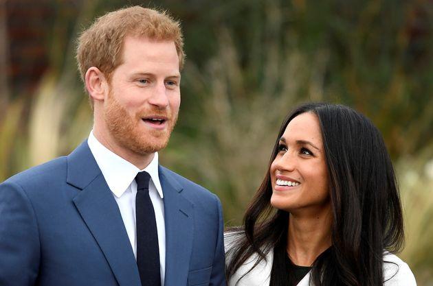 Prince Harry and Meghan Markle pose at Kensington Palace on Nov.
