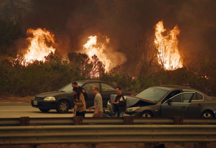 A wall of flames beside the 101 highway near Ventura, California on Dec. 6, 2017.<br><br>Homeowners living in fire-prone area