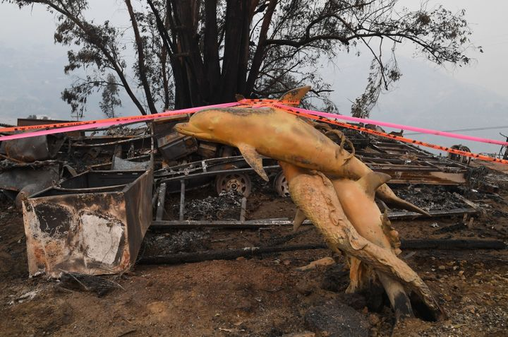 A dolphin statue is seen at a property destroyed by the Thomas fire in Carpintera, California, on Dec. 12, 2017.