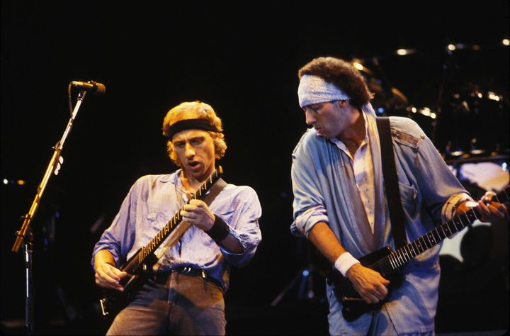 Mark Knopfler and Jack Sonni of Dire Straits perform in this undated photo.