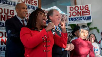 Democratic Senatorial candidate Doug Jones (C) smiles as US CongresswomanTerri Sewell (2nd L) and US Senator Cory Booker (L) campaign for him in Birmingham, Alabama, on December 10, 2017. / AFP PHOTO / JIM WATSON        (Photo credit should read JIM WATSON/AFP/Getty Images)