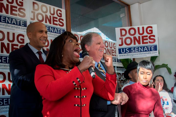 Doug Jones campaigning on Sunday with Democratic Rep. Terri Sewell of Alabama (holding microphone) and Democratic Sen. Cory B