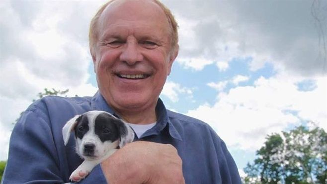 "Democratic state Sen. Raymond Lesniak holds a rescue puppy at a ""Paws Walk for a Cause"" fundraiser in New Jersey. Lesniak is"