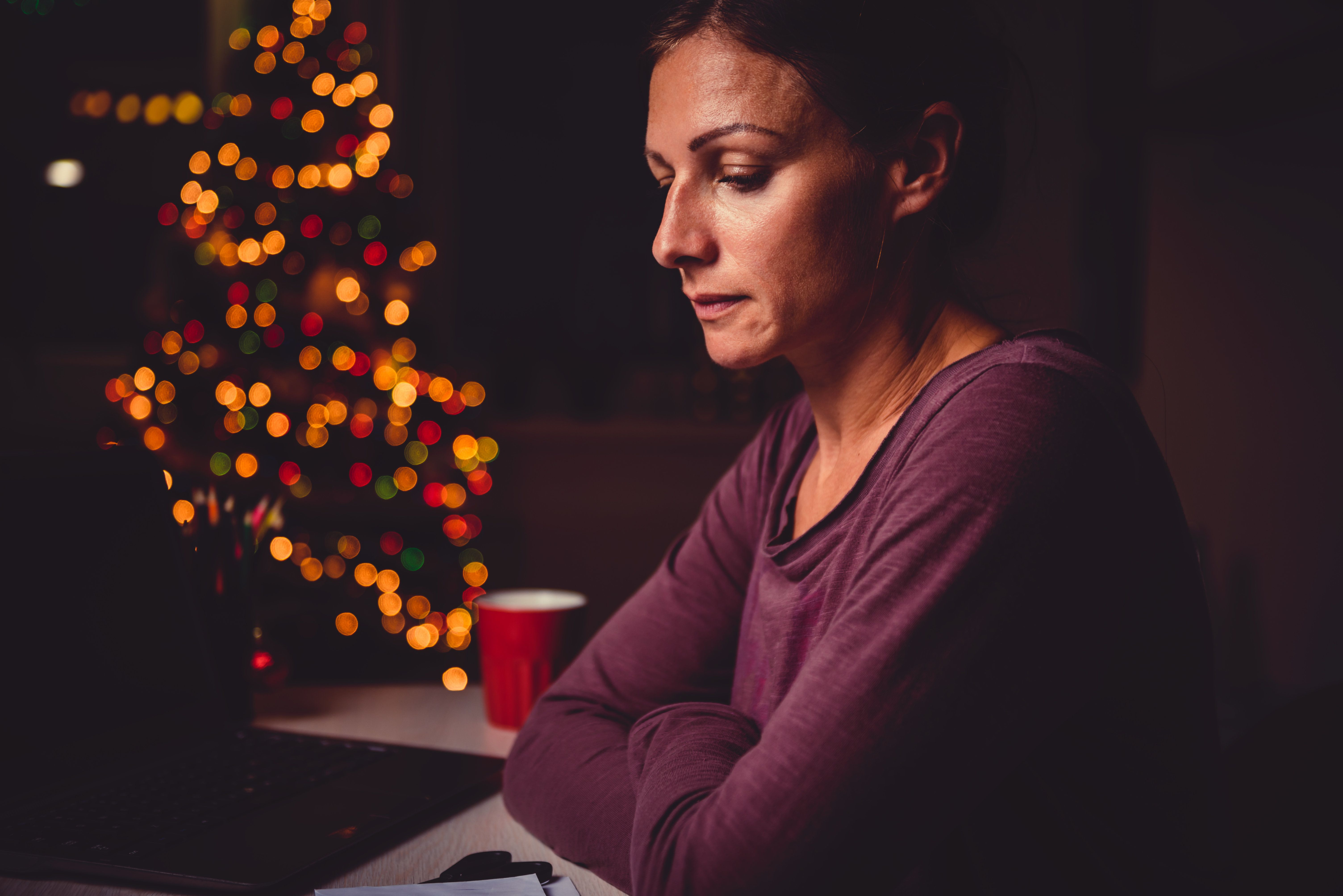 Worried woman working late night at the home office