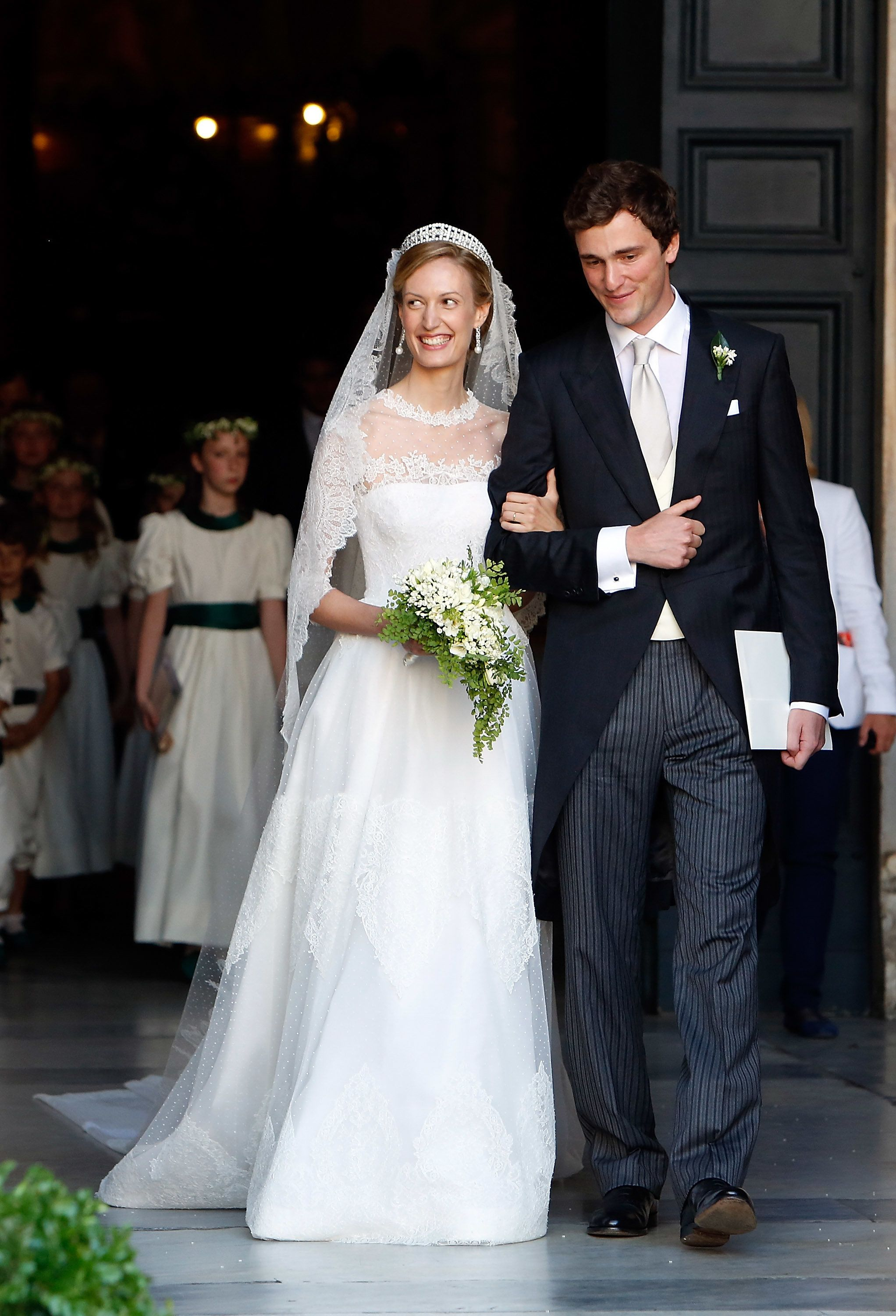 ROME, ITALY - JULY 05:  Prince Amedeo of Belgium and Princess Elisabetta Maria celebrate after their wedding ceremony at Basilica Santa Maria in Trastevere on July 5, 2014 in Rome, Italy.  (Photo by Elisabetta Villa/Getty Images)