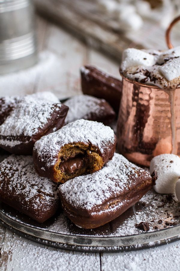 "<strong>Get the <a href=""http://www.halfbakedharvest.com/gingerbread-surprise-beignets-spiced-mocha-hot-chocolate/"" target=""_"