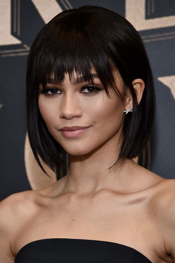 Zendaya's look is all about smooth, glowing skin, with just a hint of dark shadow on the eyes and some contouring along the c