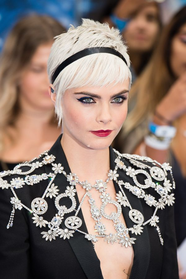 You can't travel the holiday party circuit without applying red lipstick at least once. Cara Delevingne's look is definitely