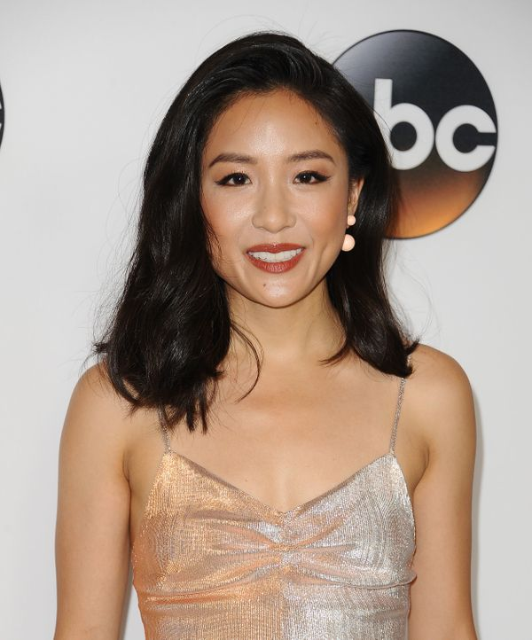 We're big fans of Constance Wu's coppery red lipstick and matching blush.The whole look is polished, elegant ande