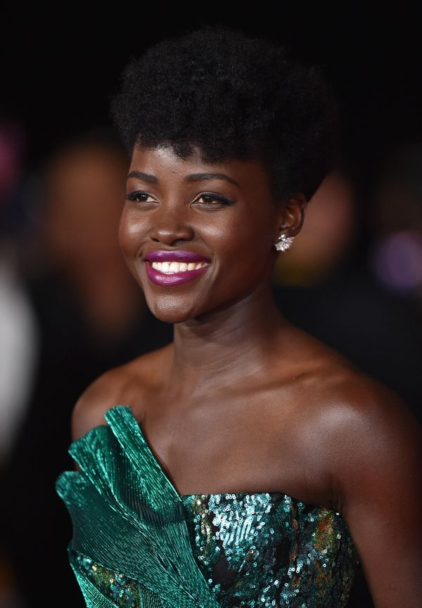 We can always count on Lupita Nyong'o to choose daring beauty looks,like this bright berry lip. It's such a fun shade a