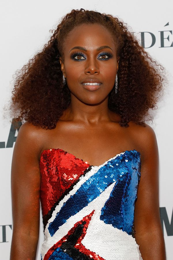 How stunning is DeWanda Wise's bright blue eyeliner? If you're looking for a bright, bold holiday look,we think we foun