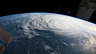 Hurricane Harvey is pictured off the coast of Texas, U.S. from aboard the International Space Station in this August 25, 2017 NASA handout photo. To match Special Report USA-FLOODS/INSURANCE  NASA/Handout via REUTERS    ATTENTION EDITORS - THIS IMAGE WAS PROVIDED BY A THIRD PARTY. THIS PICTURE WAS PROCESSED BY REUTERS TO ENHANCE QUALITY.