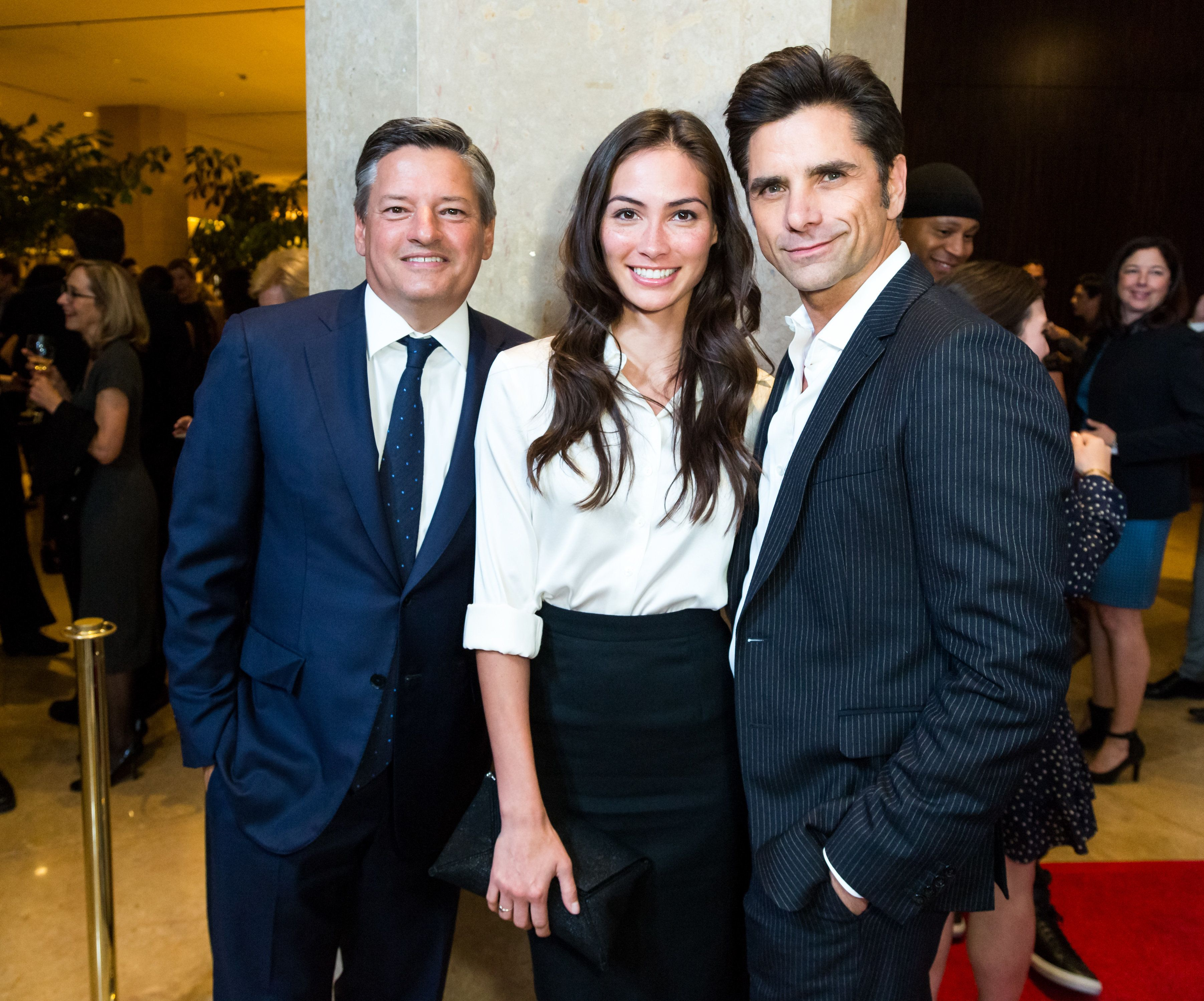BEVERLY HILLS, CA - NOVEMBER 14: Netflix Chief Content Officer Ted Sarandos, Actress Caitlin McHugh and Actor John Stamos arrive for the Saban Community Clinic's 40th Annual Dinner Gala at The Beverly Hilton Hotel on November 14, 2016 in Beverly Hills, California.  (Photo by Greg Doherty/Getty Images)