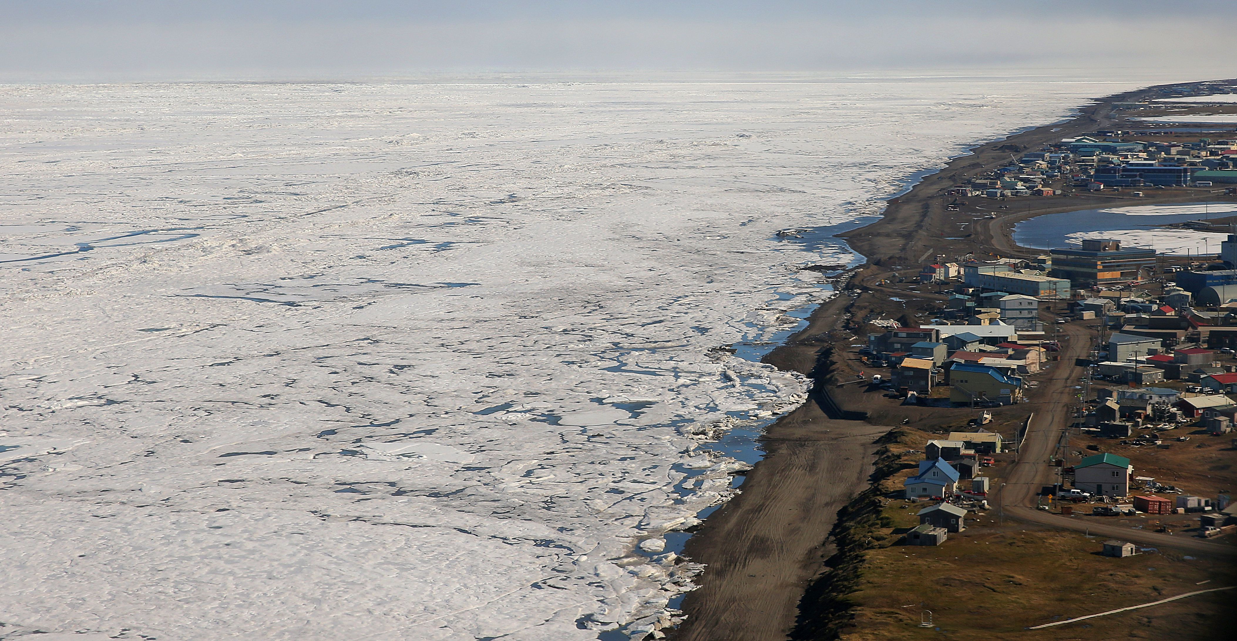 BARROW, AK - JUNE 12: An aerial view of the arctic ice from above Barrow, Alaska. Officials have sought to protect Barrow, which is fewer than 15 feet above sea level, by moving municipal buildings and lining the coast with berms and sandbags. (Photo by David L. Ryan/The Boston Globe via Getty Images)