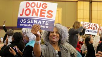 Supporters of Democratic Alabama U.S. Senate candidate Doug Jones celebrate at the election night party in Birmingham, Alabama, U.S., December 12, 2017.  Photo taken December 12, 2017.  REUTERS/Marvin Gentry