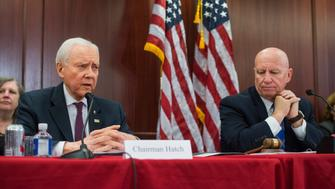 UNITED STATES - DECEMBER 13: Senate Finance Committee chairman Sen. Orrin Hatch, R-Utah, left, and Ways and Means chairman Rep. Kevin Brady, R-Texas, conduct the Senate-House Conference Committee meeting on the Tax Cuts and Jobs Act in the Capitol on December 13, 2017. (Photo By Tom Williams/CQ Roll Call)