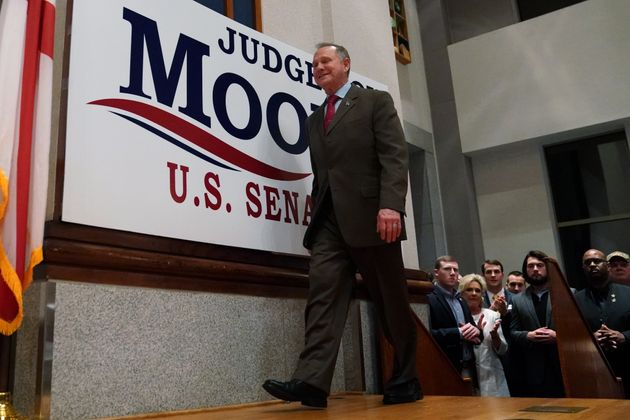 Republican U.S. Senate candidate Roy Moore walks on stage Tuesday at his election night party in Montgomery,