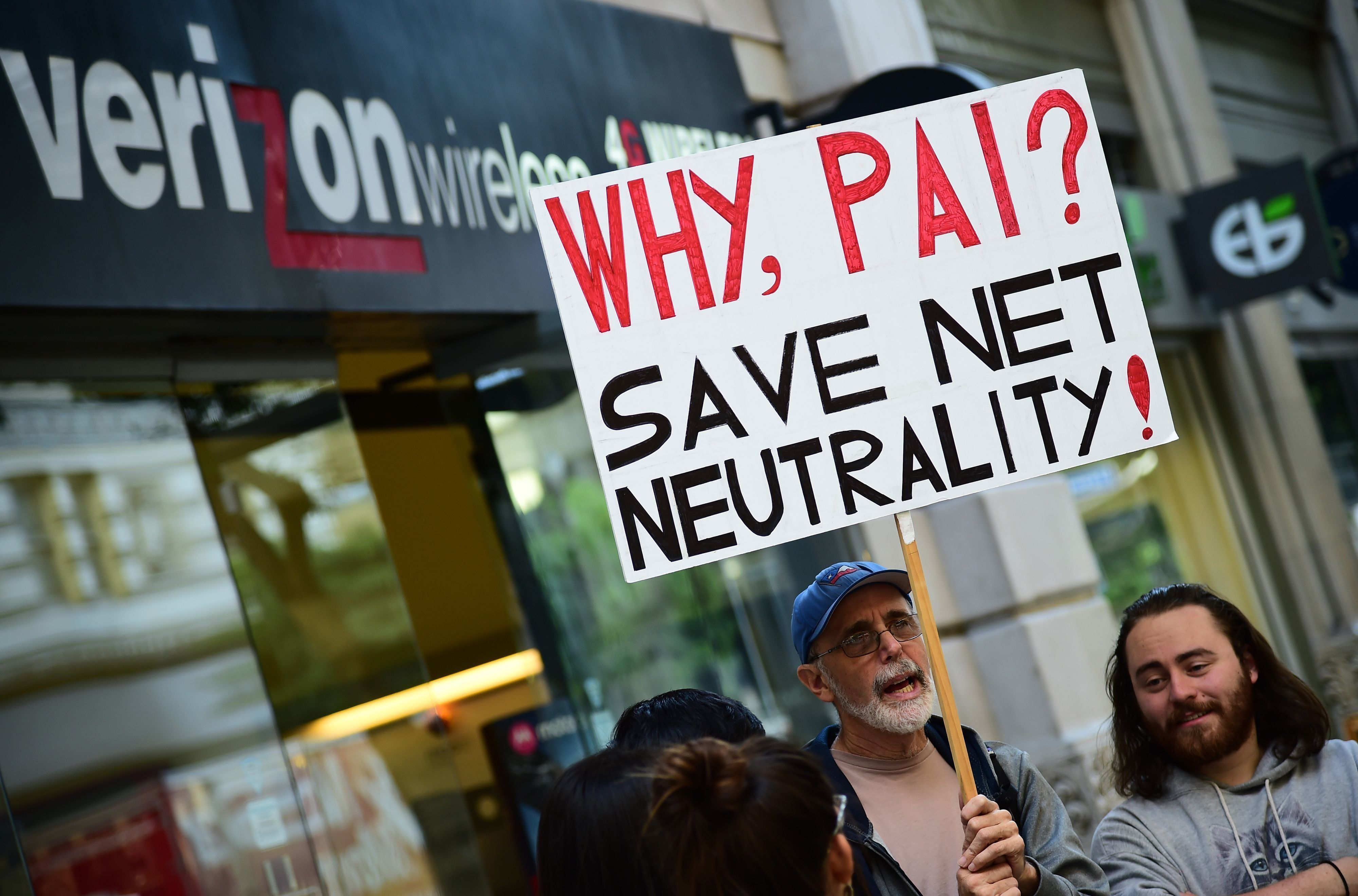 A small group of protestors supporting net neutrality protest against a plan by Federal Communications Commission (FCC) head Ajit Pai, during a protest outside a Verizon store on December 7, 2017 in Los Angeles, California.   Demonstrations in support of net neutrality are planned nation-wide at hundreds of Verizon stores and other venues. / AFP PHOTO / Robyn Beck        (Photo credit should read ROBYN BECK/AFP/Getty Images)