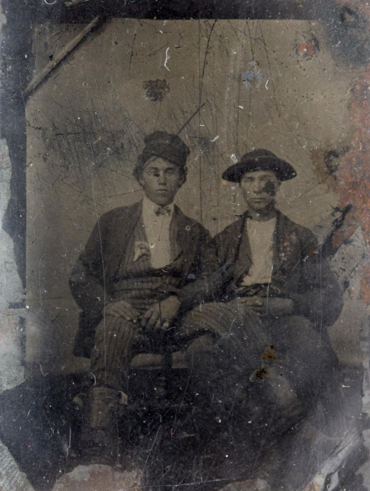 """The sixteenth-plate tintype shows two young men alleged to be  William """"Billy the Kid"""" Antrim and his brother Joseph Antrim."""