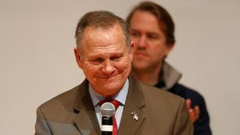 Republican U.S. Senate candidate Roy Moore pauses as he addresses supporters at his election night party in Montgomery, Alabama, U.S., December 12, 2017. REUTERS/Jonathan Bachman