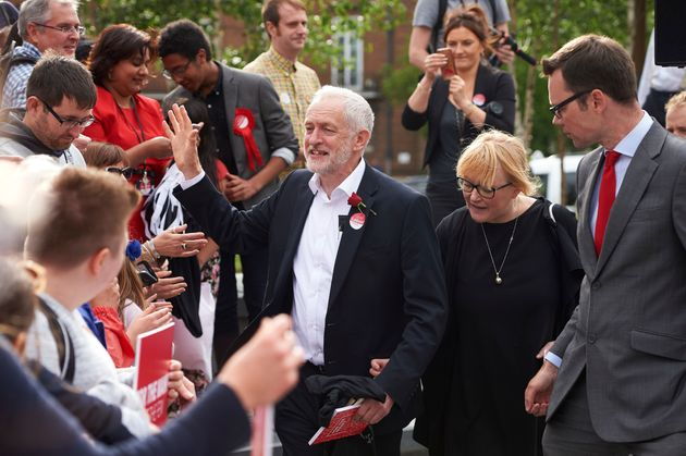 Jeremy Corbyn with candidate Chris Ostrwoski in an eve-of-poll rally in
