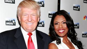 NEW YORK, NY - APRIL 01:  Businessman Donald Trump and actress Omarosa Manigault attend the 'All-Star Celebrity Apprentice' Red Carpet Event at Trump Tower on April 1, 2013 in New York City.  (Photo by Charles Eshelman/FilmMagic)