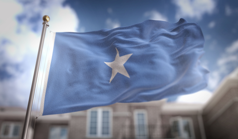 Somalia Flag 3D Rendering on Blue Sky Building Background