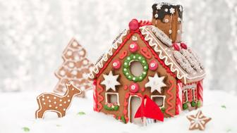 home made gingerbread house with a silver bokeh background