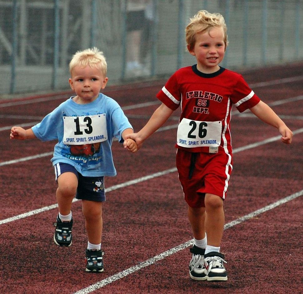 An older boy helped Chase finish a 400 meter run.The CMAK Foundationhonors this spirit of kindness, which Chase p