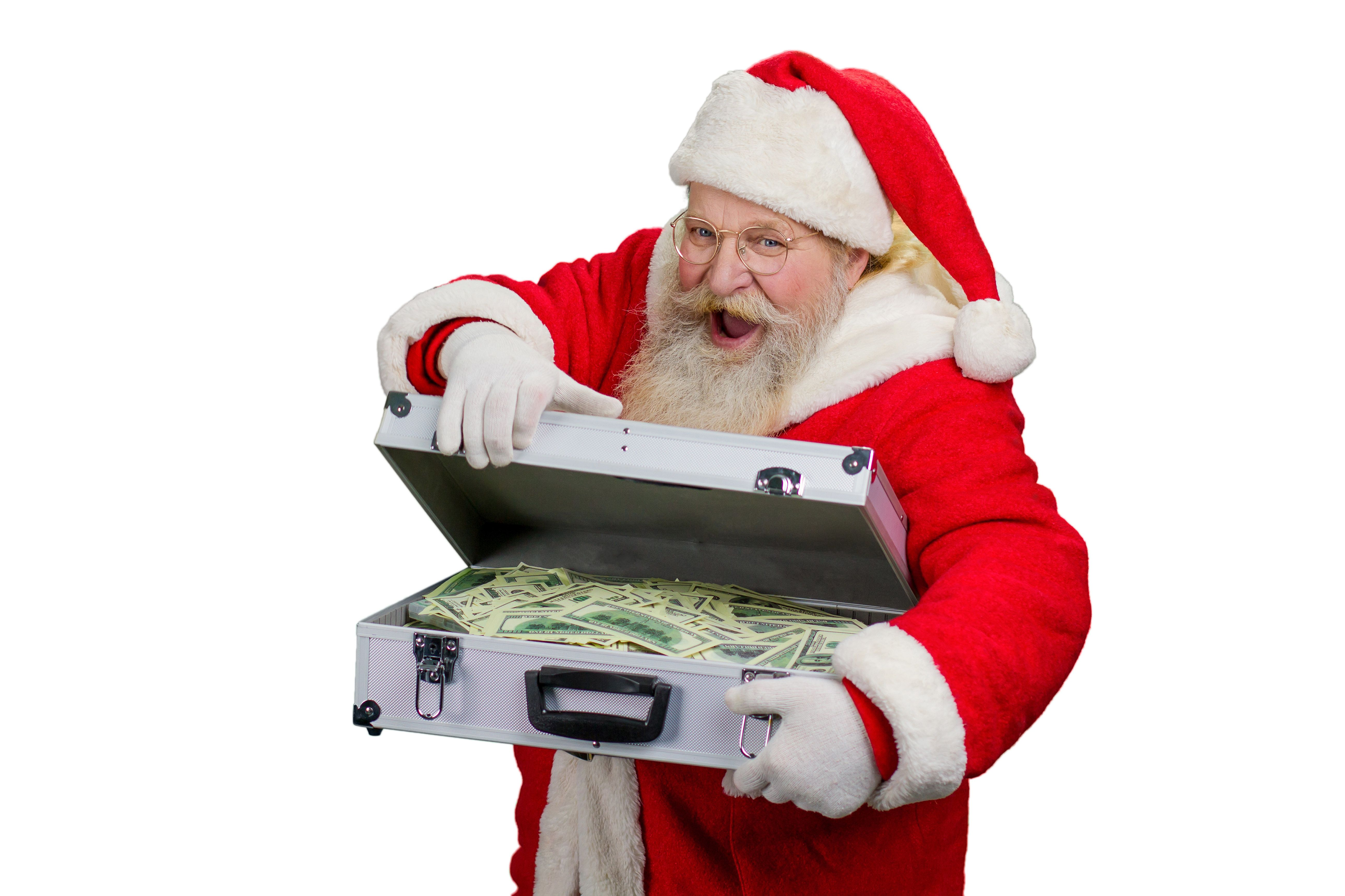 Santa Claus opening suitcase with money. Funny Santa Claus holding briefcase with hundred of dolars, isolated on white background.