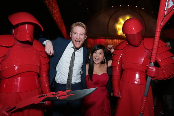 Domhnall Gleeson and Kelly Marie Tran pose with Praetorian guards at the after party for the world premiere of <em>Star Wars: