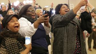 Supporters of Democratic Alabama U.S. Senate candidate Doug Jones celebrate at the election night party in Birmingham, Alabama, U.S., December 12, 2017. Picture taken December 12, 2017. REUTERS/Marvin Gentry