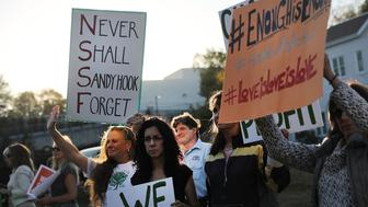 NEWTOWN, CT - OCTOBER 04:  Dozens of people attend a vigil remembering the 58 people killed in Sunday's shooting in Las Vegas and calling for action against guns on October 4, 2017 in Newtown, Connecticut. The vigil, organized by the  Newtown Action Alliance, was held outside the National Shooting Sport Foundation and looked to draw attention to gun violence in America. Twenty school children were killed at the Sandy Hook Elementary School shooting in Newtown on December 14, 2012.  (Photo by Spencer Platt/Getty Images)