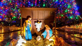 Syracuse, United States - December 26, 2015: A traditional nativity scene takes center place under the outdoor Christmas tree on Clinton Square in this upstate NY city.