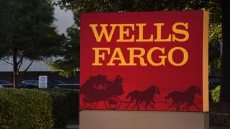 Wells Fargo & Co. signage is displayed outside a bank branch in Dallas, Texas, U.S., on Monday, July 10, 2017. Wells Fargo & Co. is scheduled to release earnings figures on July 14. Photographer: Cooper Neill/Bloomberg via Getty Images