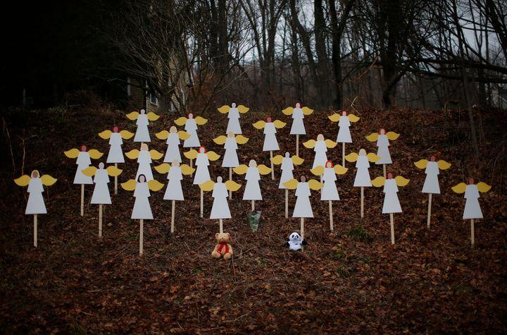 Twenty-seven angel figures were placed beside a road near the Sandy Hook Elementary School in Newtown, Connecticut on Dec. 16