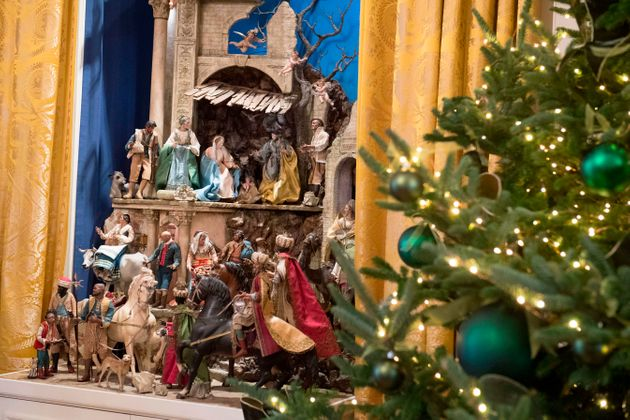 A Nativity scene and Christmas trees are seen during a preview of holiday decorations in the East Room...