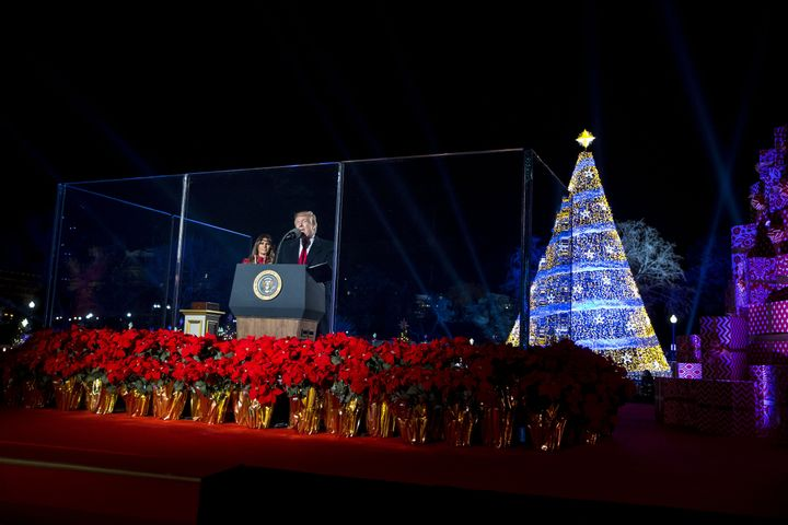 U.S. President Donald Trump, right, speaks as first lady Melania Trump attends the 95th Annual National Christmas Tree Lighti