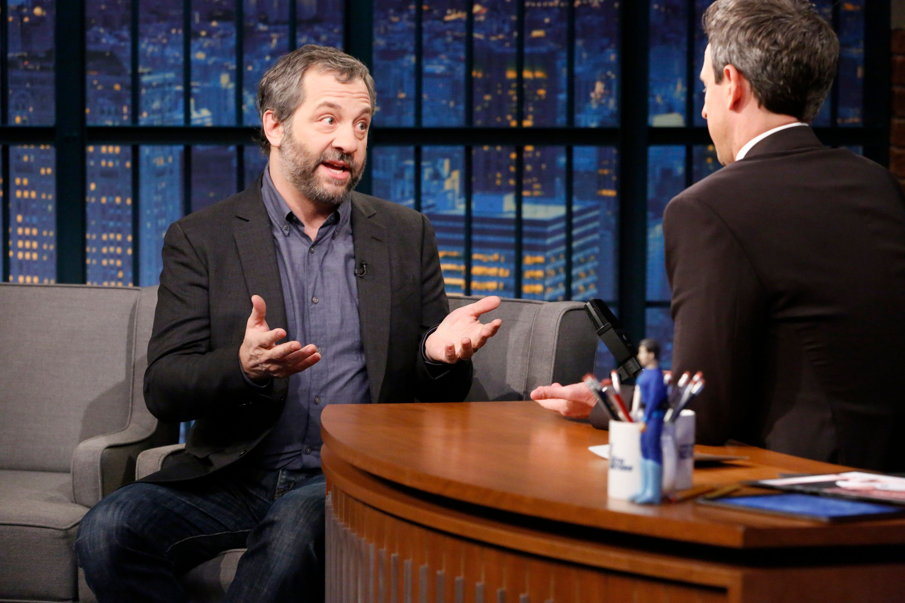 LATE NIGHT WITH SETH MEYERS -- Episode 625 -- Pictured: (l-r) Director Judd Apatow during an interview with host Seth Meyers on December 13, 2017 -- (Photo by: Lloyd Bishop/NBC/NBCU Photo Bank via Getty Images)
