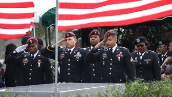HOLLYWOOD, FL - OCTOBER 21:  Members of the 3rd Special Forces Group (Airborne) 2nd battalion Fse salute the casket of U.S. Army Sgt. La David Johnson at his burial service in the Memorial Gardens East cemetery on October 21, 2017 in Hollywood, Florida. Sgt. Johnson and three other American soldiers were killed in an ambush in Niger on Oct. 4.  (Photo by Joe Raedle/Getty Images)