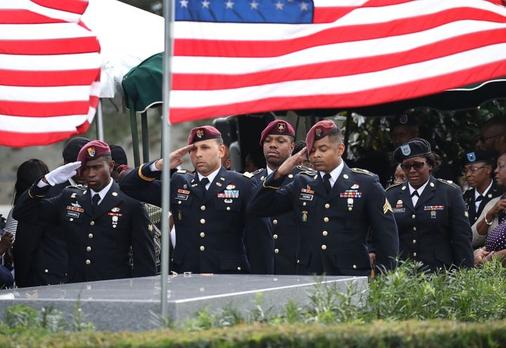 Members of the 3rd Special Forces Group salute the casket of U.S. Army Sgt. La David Johnson at his burial service on October