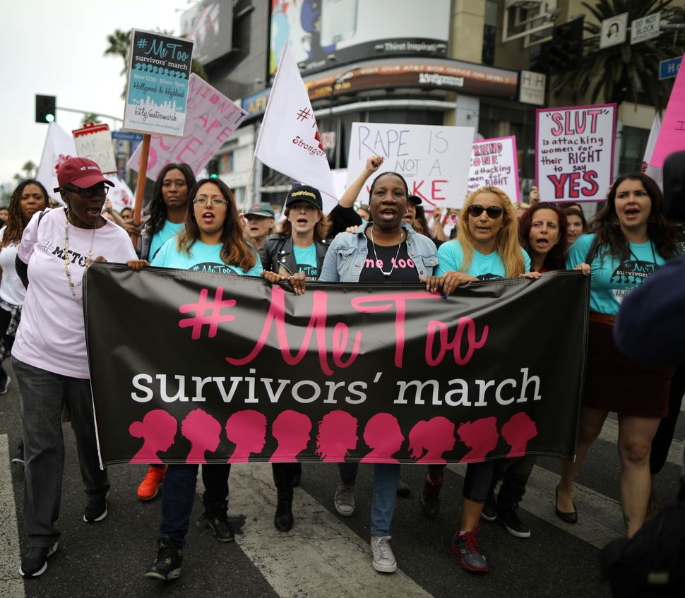 People participate in a march for survivors of sexual assault inLos Angeles, California,on Nov. 12, 2017.