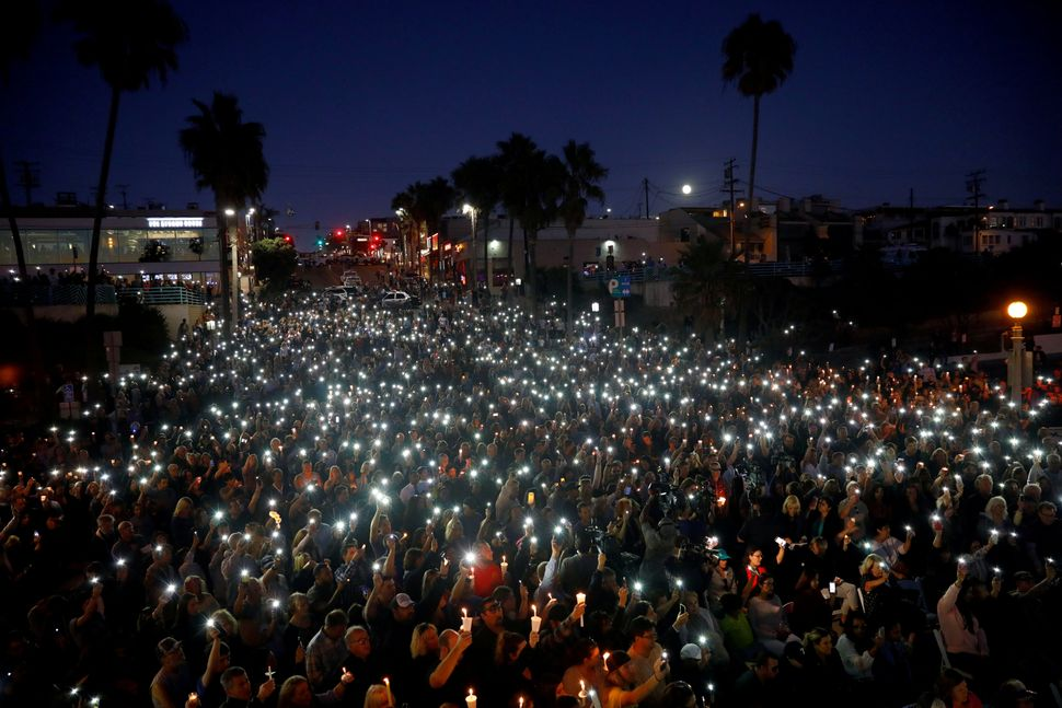 People in Manhattan Beach, California, hold a vigil for victims of the shooting in Las Vegas on Oct. 1, 2017.